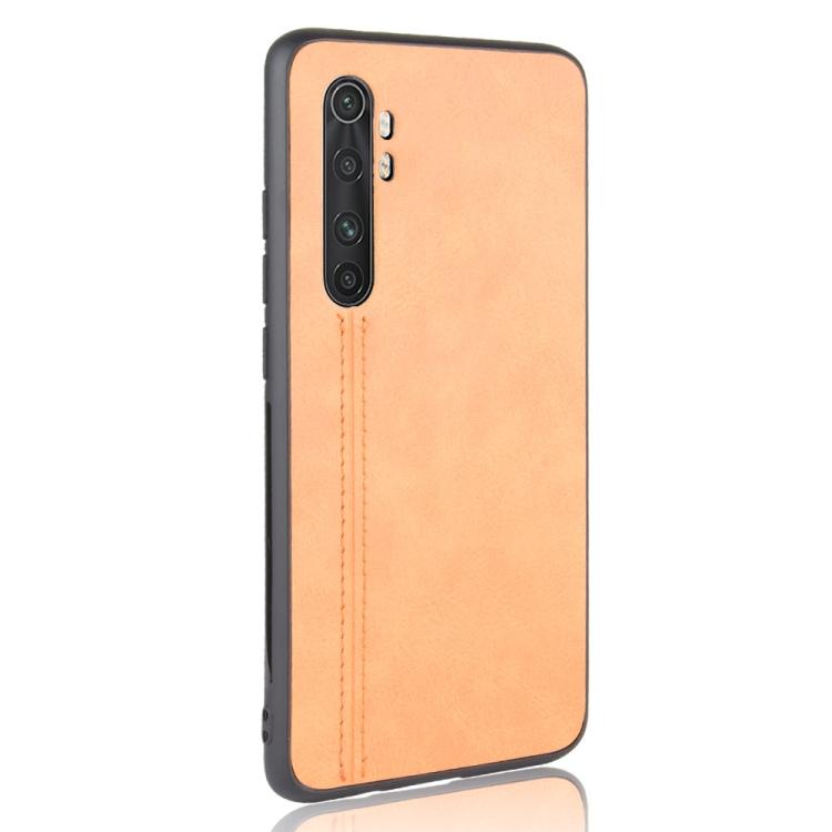 For Xiaomi Mi Note 10 Lite Shockproof Sewing Cow Pattern Skin PC + PU + TPU Case(Orange)